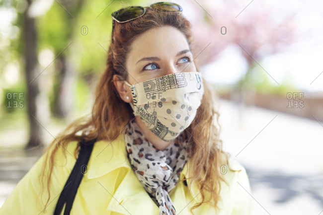 Woman wearing face mask outdoors