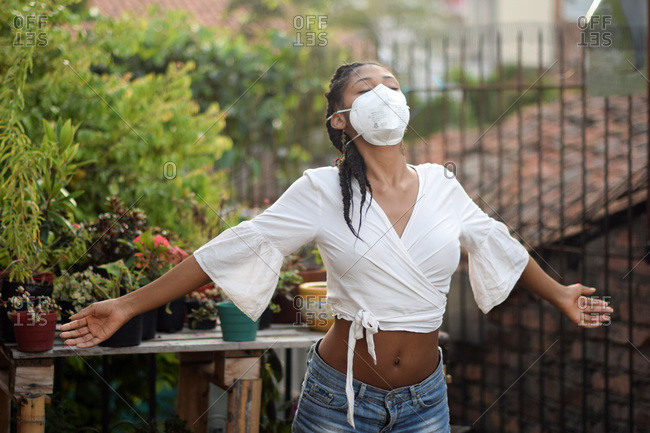 Young woman wearing a face mask in, Bogota, Colombia, during the 2019-20 outbreak of the new coronavirus SARS-CoV-2.