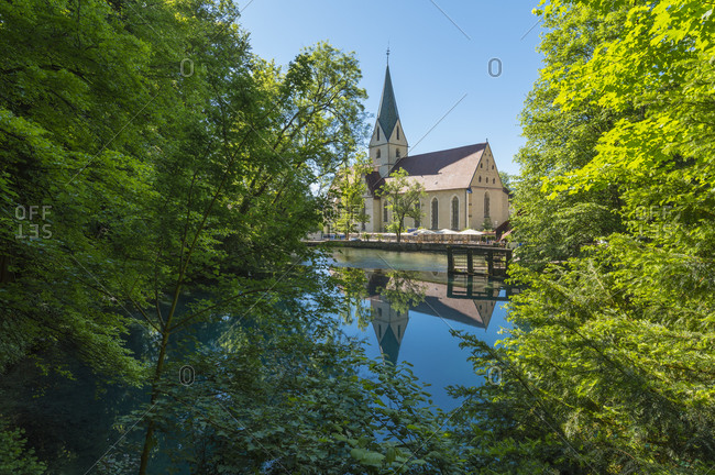 Water rich source of the river blue with church, Blautopf, Blaubeuren, Swabian Alb, Baden-Wurttemberg, Germany