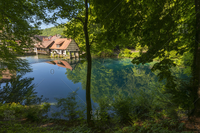 Water rich source of the river blue with watermill, Blautopf, Blaubeuren, Swabian Alb, Baden-Wurttemberg, Germany