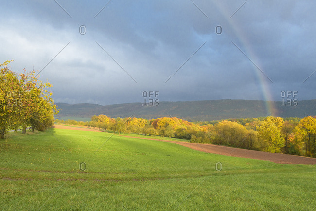 Landscape with rainbow in autumn, Grossheubach, Spessart, Bavaria, Germany