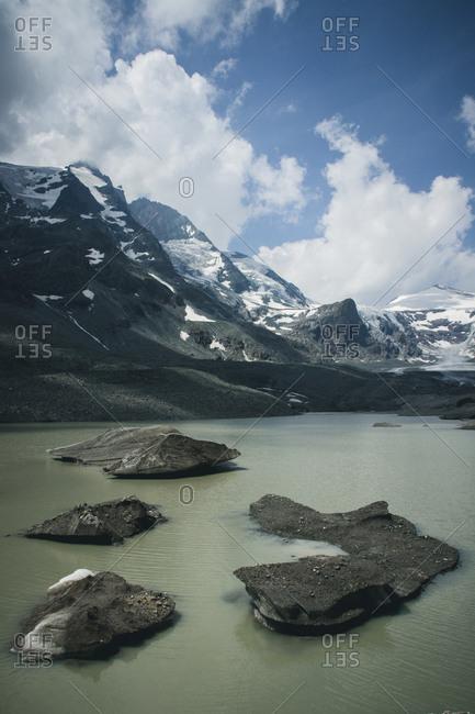 Austria, State of Salzburg, Grossglockner High Alpine Road, mountains, lake, melt water