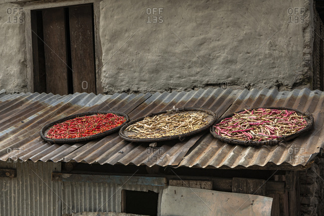Chilli pods and beans to dry on a roof in Nepal