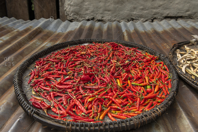 Chilli pods to dry on a roof in Nepal