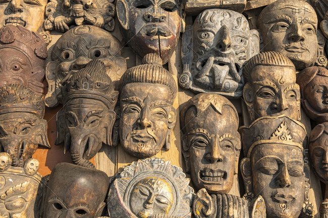 Souvenir shop with typical wooden masks in Kathmandu in Nepal. The masks are traditionally worn at the Mani Rimdu festival to drive out demons and reward believers.