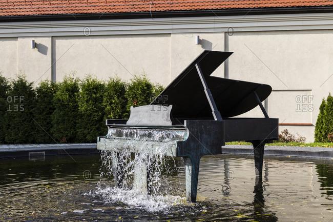 October 16, 2019: Europe, Poland, Silesian Voivodeship, Koszecin, Fountain in the shape of a piano