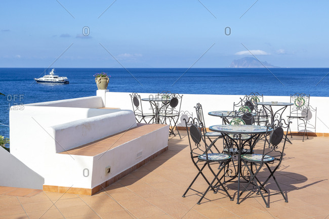 Roof-top hotel Punta Barone on the island of Salina with a view of the island of Panarea, Aeolian or Aeolian Islands, Sicily, Italy