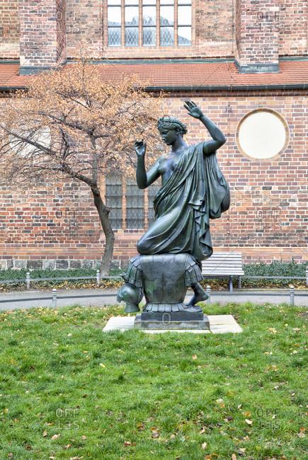 December 3, 2019: Bronze statue klio, Clio, the muse of history, Albert Wolff, 1876, Nikolaikirche, Nikolaiviertel, Berlins historical center, Berlin, Germany