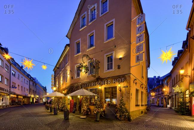 December 21, 2019: Hotel Bayerischer Hof, blue hour, Christmas decoration, old town, Kitzingen, Franconia, Bavaria, Germany, Europe