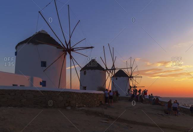 June 9, 2019: Windmills Kato Mili at sunset, Mykonos Town, Mykonos, Cyclades Islands, Greece