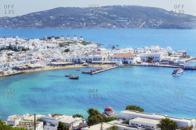 June 11, 2019: Mykonos Town and old harbour, elevated view, Mykonos, Cyclades Islands, Greece