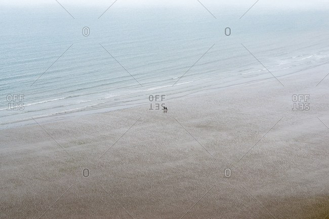 People walking on the beach at Rhossili Bay on The Gower in south Wales