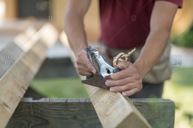 A man planing wood by hand