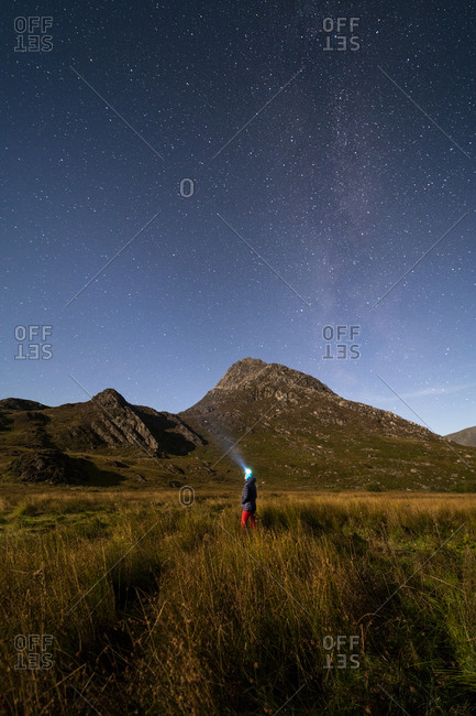 Looking up at the stars in Snowdonia with Tryfan in the distance