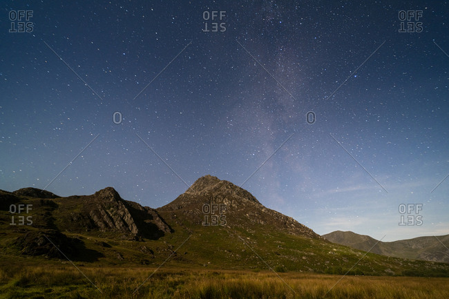 Stars in Snowdonia with Tryfan in the distance