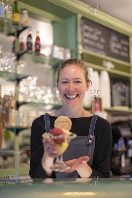 September 16, 2019: A woman serves a colorful ice cream in a parlor in Hay-on-Wye in Wales