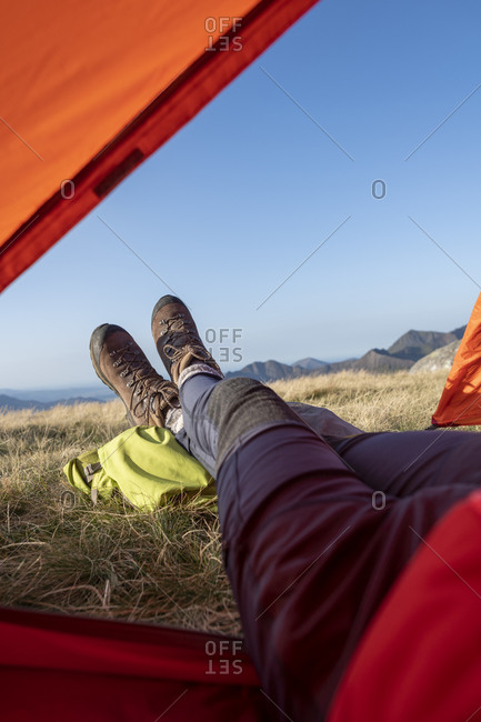 Wild camping on the summit of Glyer Fach in Snowdonia with a view of Snowdon from the tent