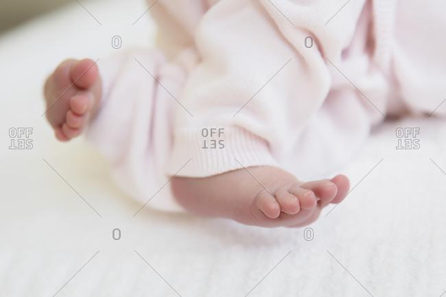 Tiny baby feet close up