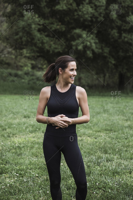 Woman standing in a field doing yoga