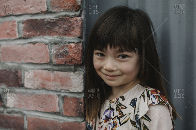 Close up of a young girl in flower dress