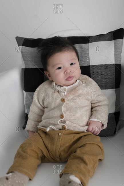 Baby boy in a cardigan