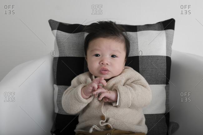 Portrait of a baby boy in a cardigan