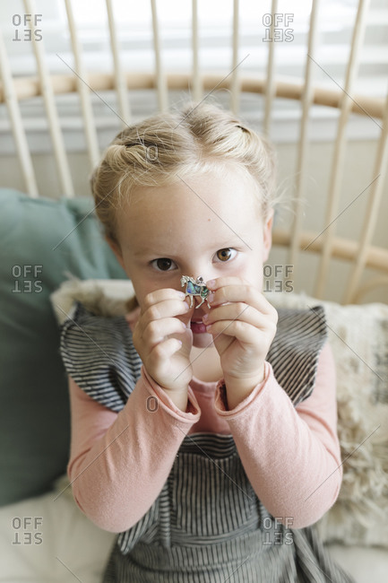 Blonde girl holding a horse charm