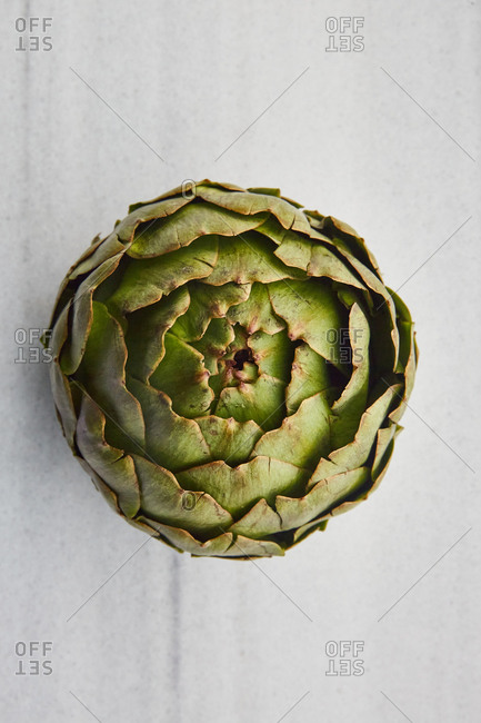 Close-up natural artichoke on a marble surface