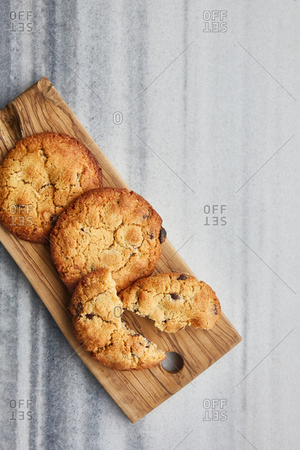 Cookies on a wooden board on a marble surface