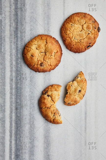 Overhead view of chocolate chip cookies on a marble surface
