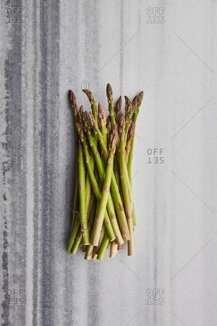 Fresh asparagus on a marble surface