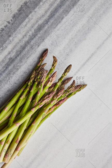 Fresh asparagus bunch on a marble surface