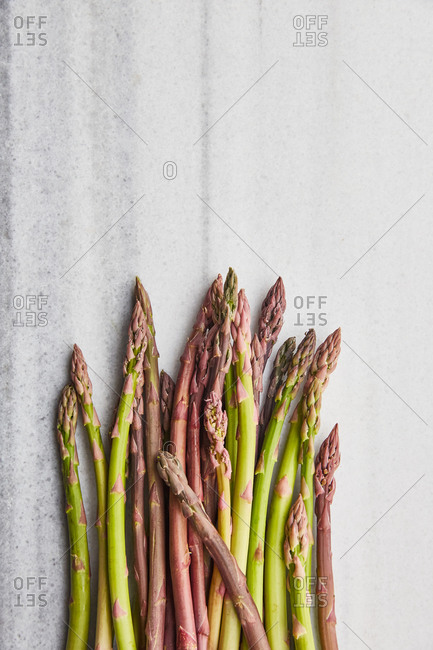 Top view of fresh asparagus on a marble surface