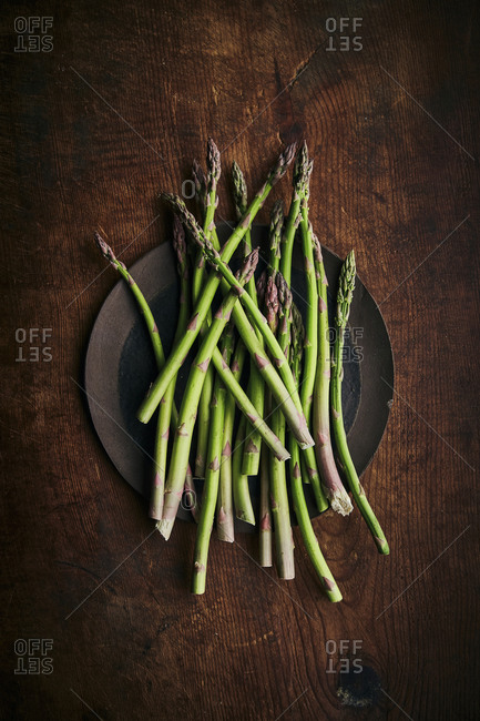 Fresh asparagus on a wooden rustic surface