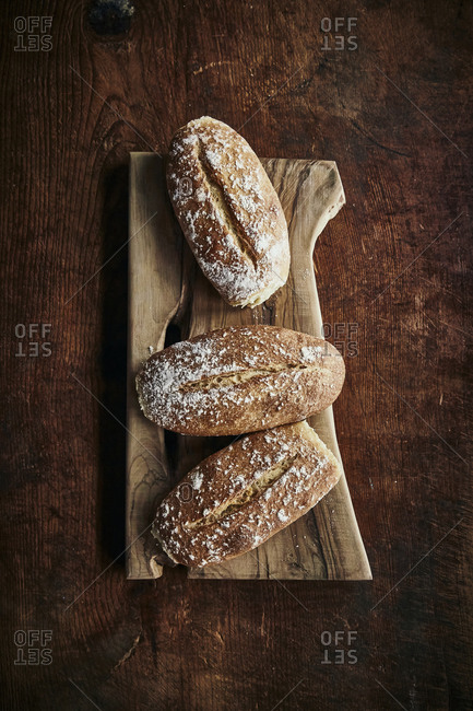 Homemade breads on a wooden rustic surface