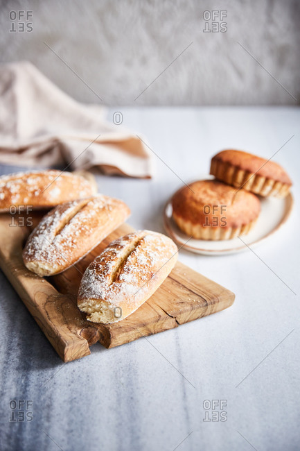 Homemade artisan breads on a white marble surface
