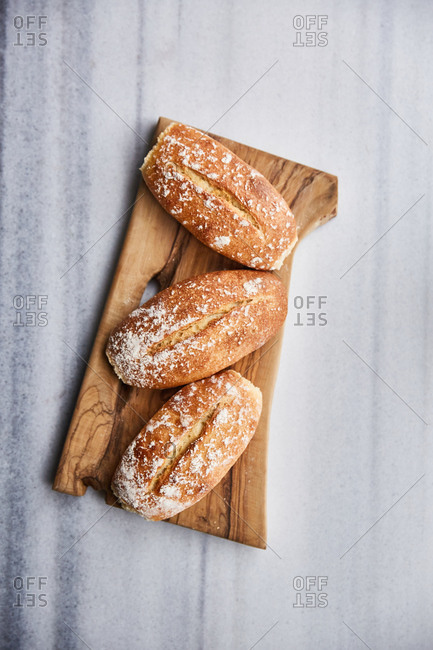 Homemade breads on a marble surface