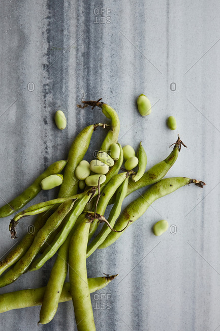 Organic broad bean on a marble surface
