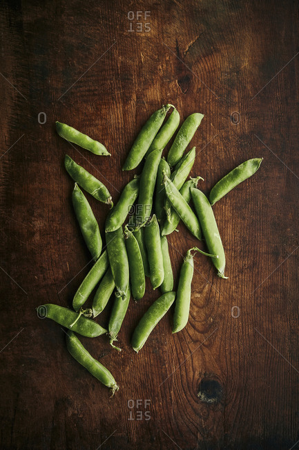 Organic green peas on a wooden rustic surface