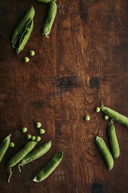 Top view of organic green peas on a wooden rustic surface