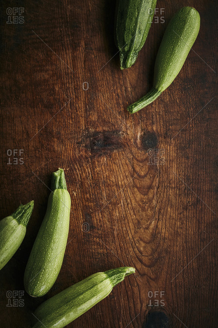 Fresh zucchinis on a wooden rustic surface