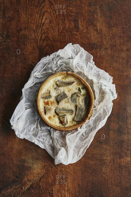 Baked artichoke tart on a rustic surface