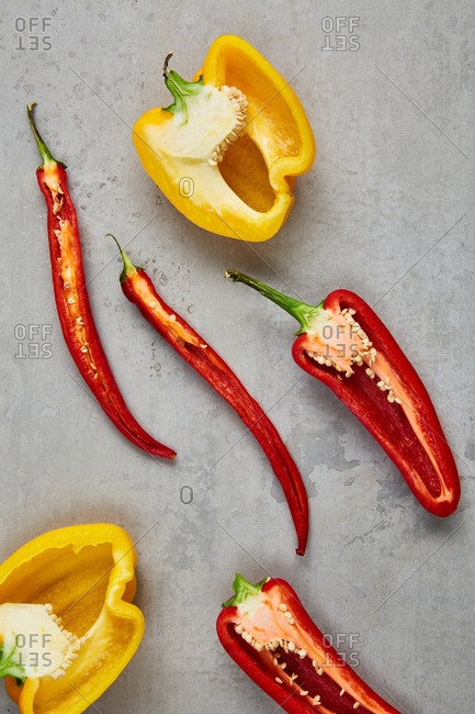Horizontally cut yellow and red peppers