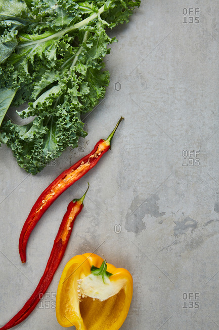 Cut yellow and red peppers with fresh kale