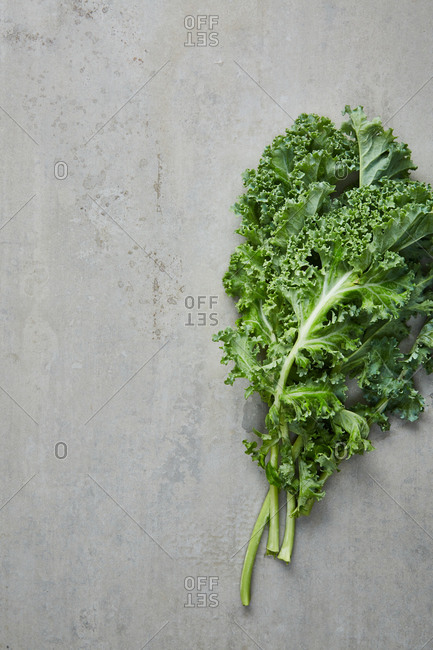Fresh kale on a grey surface