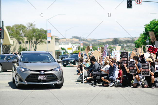San Francisco Bay Area, California - June 1, 2020: Group of people holding signs and standing in road during a Black Lives Matter protest