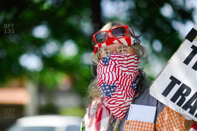 Portrait of a senior man wearing a flag bandana as mask at a Black Lives Matter protest