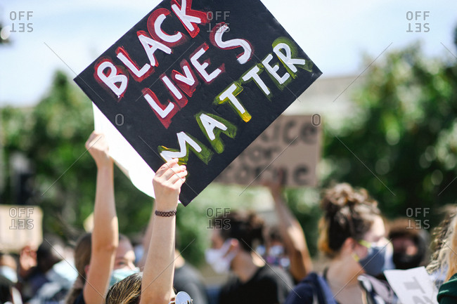 Teens holding up signs at Black Lives Matter protest