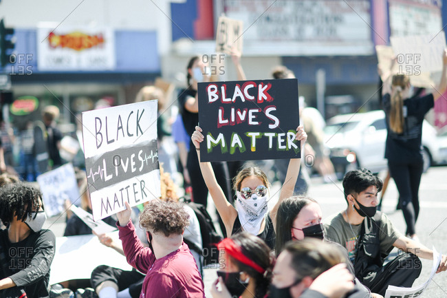 San Francisco Bay Area, California - June 1, 2020: Large group of teens gathered at a rally with signs for Black Lives Matter protest