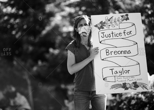 "San Francisco Bay Area, California - June 8, 2020: Black Lives Matter protestor holding a signs reading ""Justice for Breonna Taylor"""